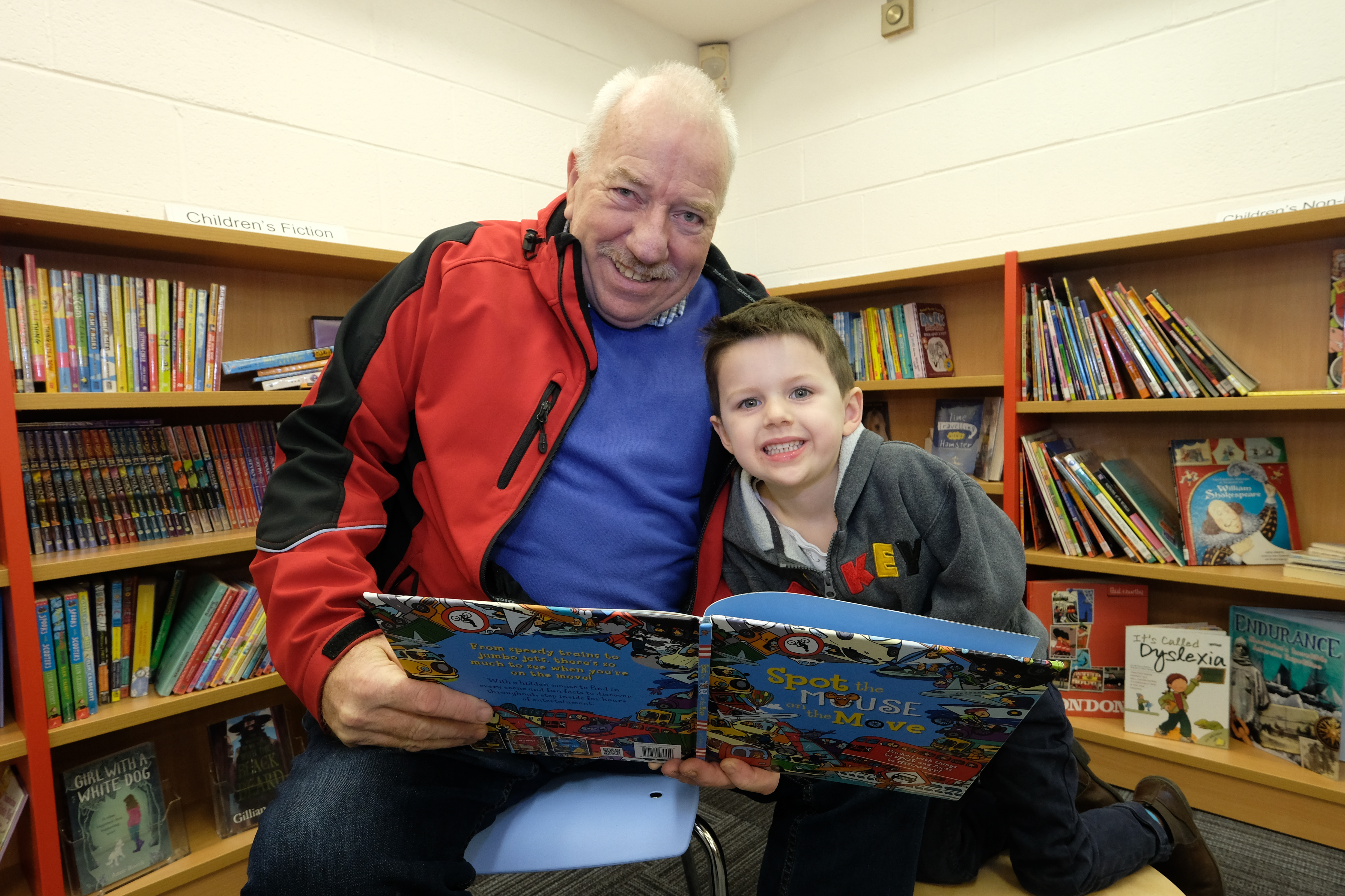 Peter Jones shares a picture book with his 4 year old grandson Seth