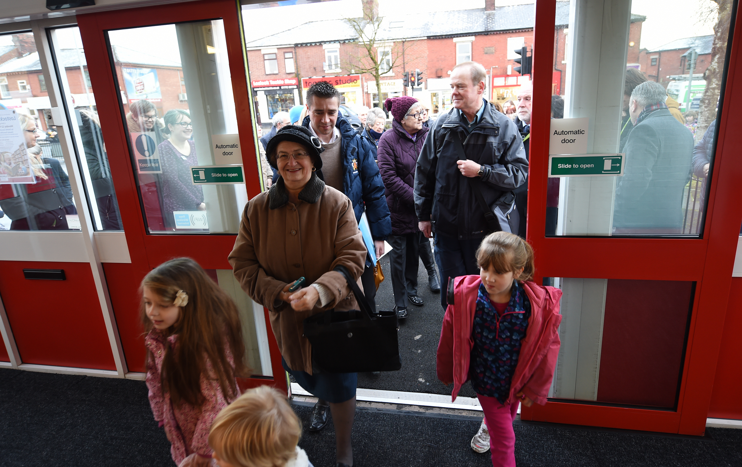 Delighted members of the public entering Lostock Hall library